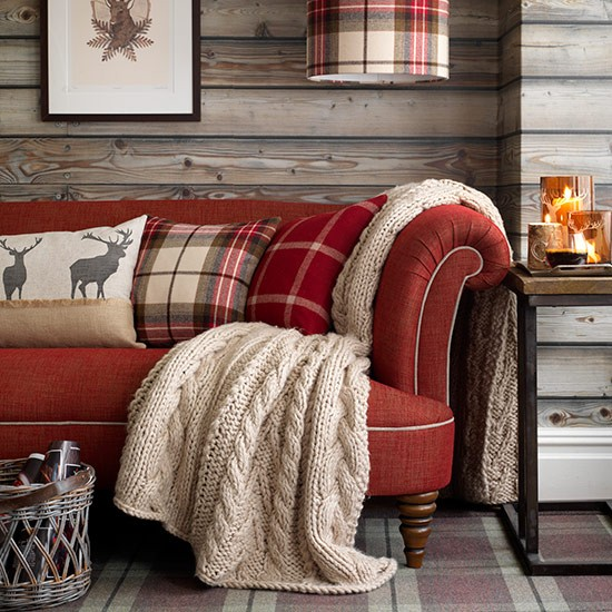 Red-sofa-in-highland-style-living-room--Country-Homes-and-Interiors--Housetohome.co.uk
